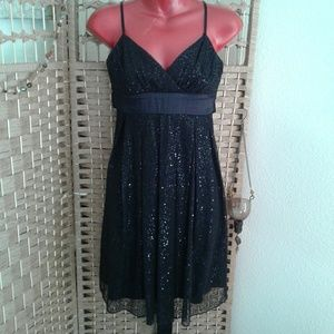 Black sequined party dress. So cute